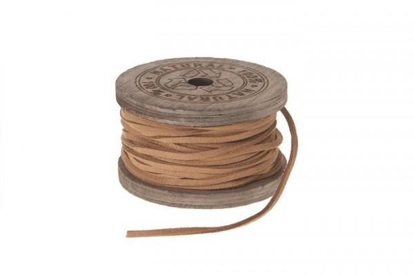 Lederband auf Holzrolle